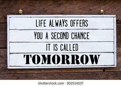 Life Always Offers You A Second Chance, Is Called Tomorrow Inspirational message written on vintage wooden board. Motivation concept image