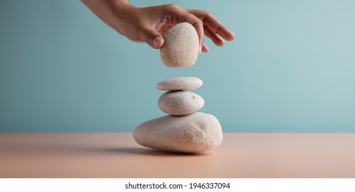 Life Balance Concept. Hand Setting White Natural Zen Stone Stack. Balancing Mind, Soul and Spirit. Mental Meditation Practice