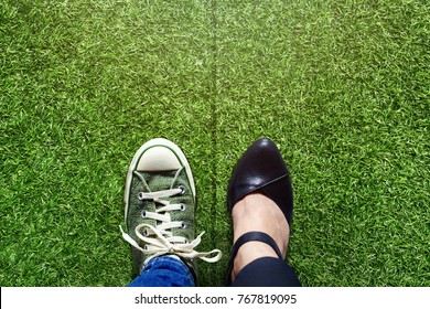 Life Balance concept for Work and Travel present in top view position over green grass field by half of Business Working Woman and Sneaker Shoes