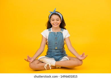 Life balance. Good vibes. Peaceful meditating. Learn meditating techniques. Stay positive and optimistic. Private space to relax. Yoga training. KId adorable girl sit meditate. Meditating practice.