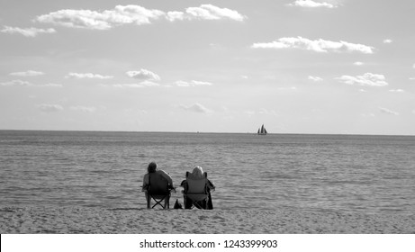Life is a Beach - A couple enjoy the sea, sand and view Chatham, MA.
