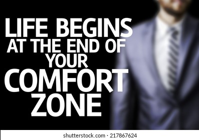 Life Begins at the end of Your Comfort Zone written on a board with a business man on background