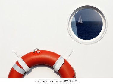 Life belt and porthole window with reflection on ship
