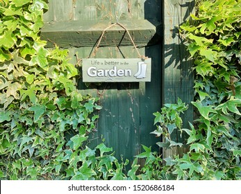 Life is better in the garden board with ivy leaves
