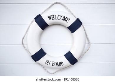 Life buoy decoration on white wooden background
