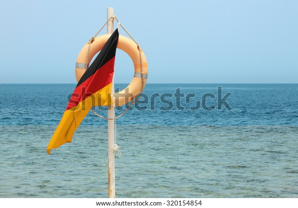 life buoy and flag Germany - conceptual sign - refugees - Immigration