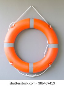 Life buoy on cement wall  background