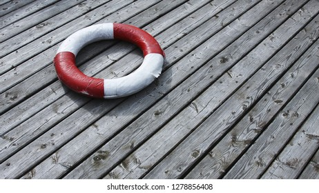 A life buoy on wooden floor