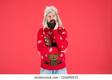 Life changing decision. Hipster bearded man wear winter sweater and hat. Happy new year. Winter party outfit. Man thoughtful face expression. Hard decision. Decision making. Make christmas wish.