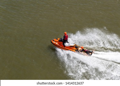 Life and coast guards get training and cruising on their jet-skie scooter on the calm North-Sea water