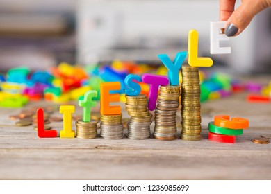 Life cost or cost of living concept with colorful letters on ascending piles of money