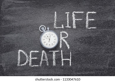 life or death written on chalkboard with vintage stopwatch used instead of O