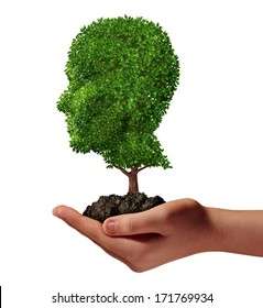 Life development concept with a hand holding a green tree shaped as a human head as a nurture metaphor and nature symbol for protection of the environment and growth potential.