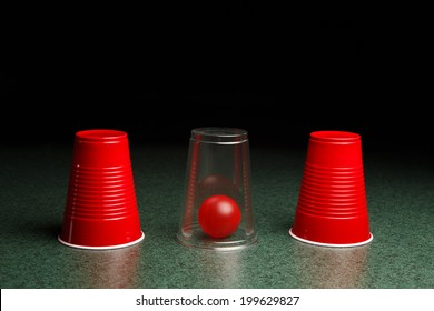 Life is easy when you know the answers.  Location of red ball is revealed by clear cup.  Copy space.