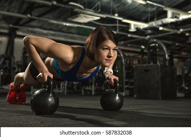 53a27def5f573 Life of fitness. Attractive young gym fitness woman doing push-ups with  weights beautiful