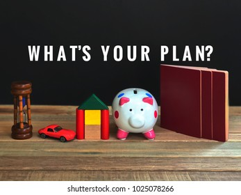 Life and future planning concept - 'What's your plan?' wording with vintage styled background of a toy hourglass, toy car, toy blocks house, piggy bank and passports.