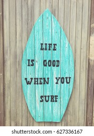 Life is good when you surf - grungy wooden sign