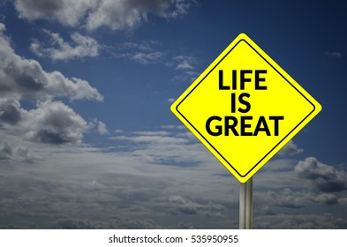Life is great road sign with blue sky background