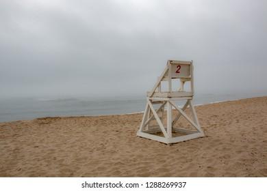 life guard chair on foggy beach