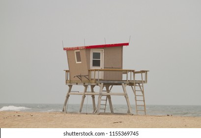 Life guard station on foggy beach