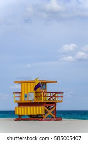 A life Guard Station sits on the beach during a summer day.