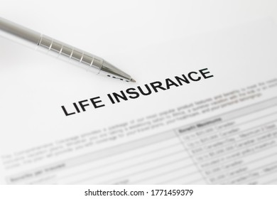 Life insurance document with pen nearby