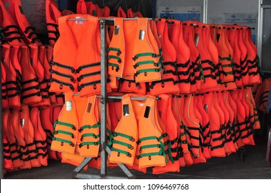 life jacket in orange color important for life security in the water or the sea and The ocean for everybody even someone who can swim need to put on it too.