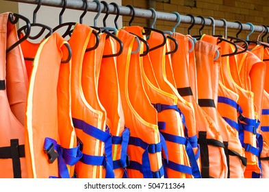 Life jackets hanging on the row