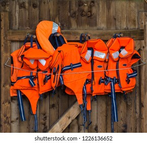 Life jackets hanging on a wooden door