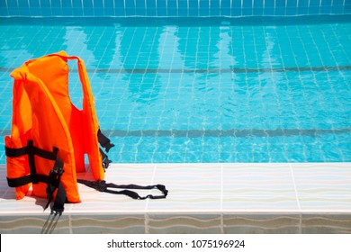 Life jackets in the pool.
