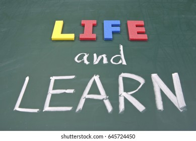 Life and learn, lifestyle words on blackboard.