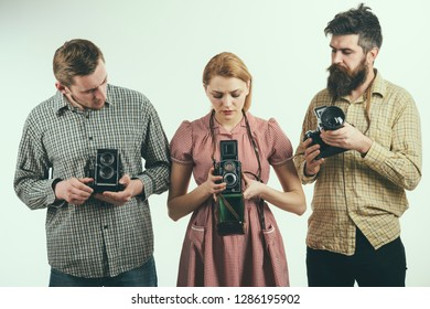 Life is like a camera. Retro style woman and men hold analog photo cameras. Group of photographers with retro cameras. Paparazzi or photojournalists with vintage old cameras. Photography studio.