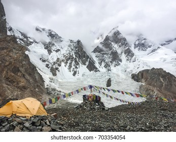 Life is not easy.We can not see K2 peak at base camp after several hours of trekking on the cloudy day.There are only yellow tent and colorful prayer flags at the oblation site.