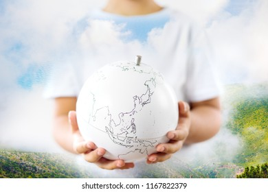 Life on earth - environment and ecology concept double exposure earth globe in child hands and nature landscape