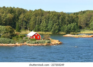 Life on small island. Red house on rocky shore of Baltic Sea. Aland Islands, Finland