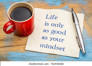 Life is only as good as your mindset - handwriting on a napkin with a cup of coffee
