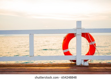 A life orange buoy for safety at sea.