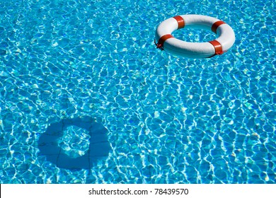 Life preserver floating in a clear pool water