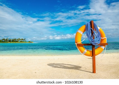 Life preserver on exotic sandy beach