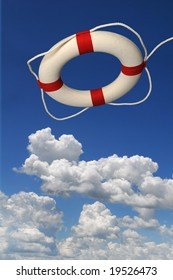 Life preserver over a blue sky with bright clouds