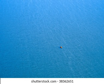 Life raft on sea background. View from above.