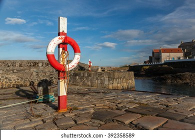 Life ring at Portsoy Harbour, Aberdeenshire, Scotland UK.