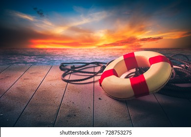 life saver on a dock at the beach on a sunny day