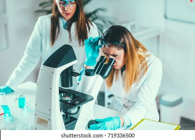 Life science research, placing sample under the microscope