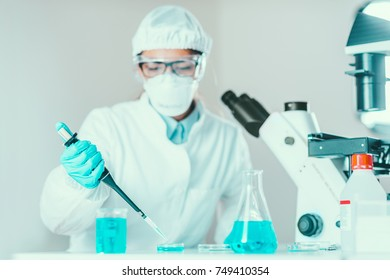 Life science research. Technician using micro pipette