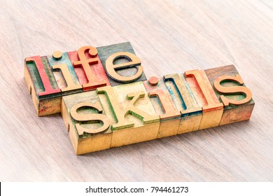 life skills - word abstract in letterpress wood type printing blocks