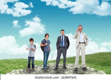 Life stages of businessman against field and sky