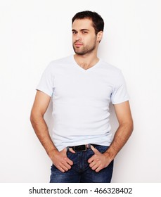 life style  and people concept: handsome man in light blue shirt, studio shot over  white background.