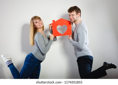 Life together. First big step in relationship. Young smiling couple in love dream plan future in their new house home. Lovely enamoured marriage full of good feelings.