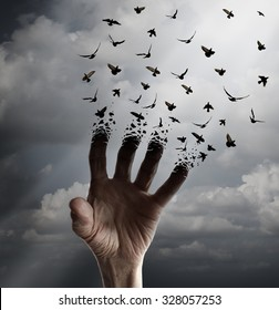 Life transformation concept as a hand reaching out transforming into flying birds following sunlight as a freedom symbol of hope renewal and spirituality or human faith.